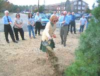 Mrs. Jerry helps plant tree in her husbands honor.
